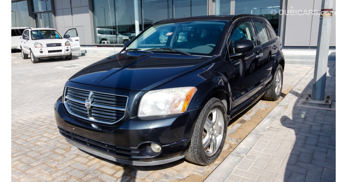 dodge caliber sx for sale aed 19 000 grey silver 2007. Black Bedroom Furniture Sets. Home Design Ideas
