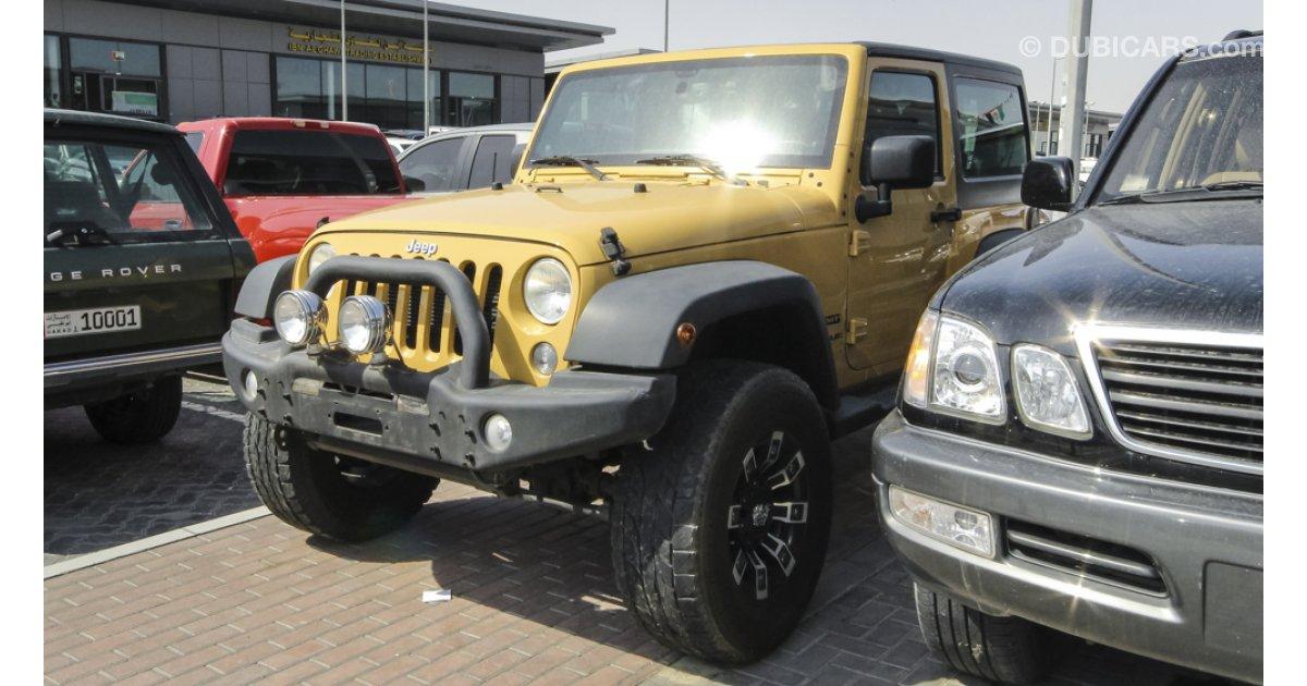 jeep wrangler sport for sale aed 85 000 beige 2014. Black Bedroom Furniture Sets. Home Design Ideas