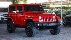 Jeep Wrangler Pre owned Jeep Wrangler Sahara for sale in Ajman by Auto Perfect. 6 cylinder engine, red exterior an