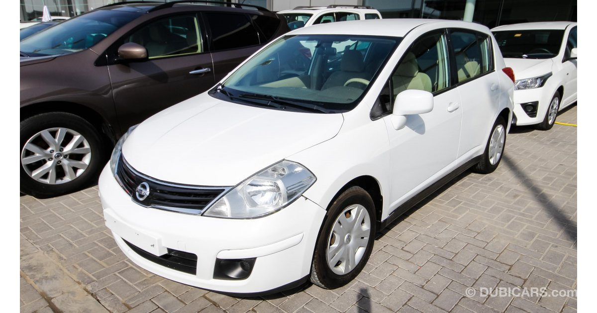 Nissan tiida 1 8 for sale aed 17 000 white 2011 for Motor world used cars