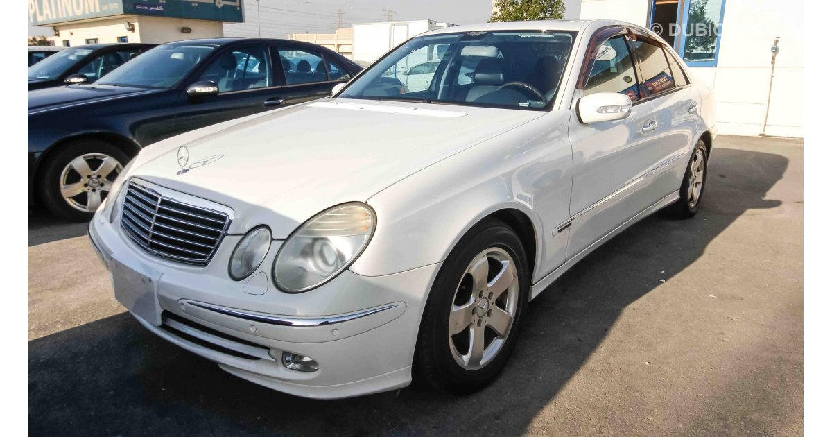 mercedes benz e 500 for sale aed 23 000 white 2004. Black Bedroom Furniture Sets. Home Design Ideas