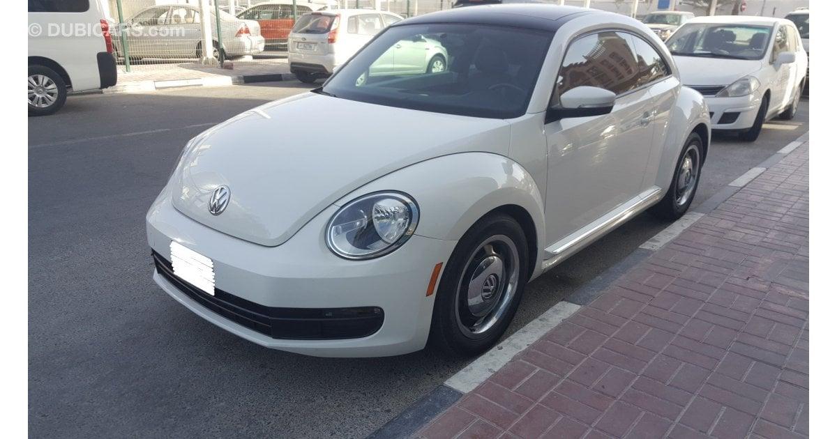 volkswagen beetle for sale aed 35 000 white 2012. Black Bedroom Furniture Sets. Home Design Ideas