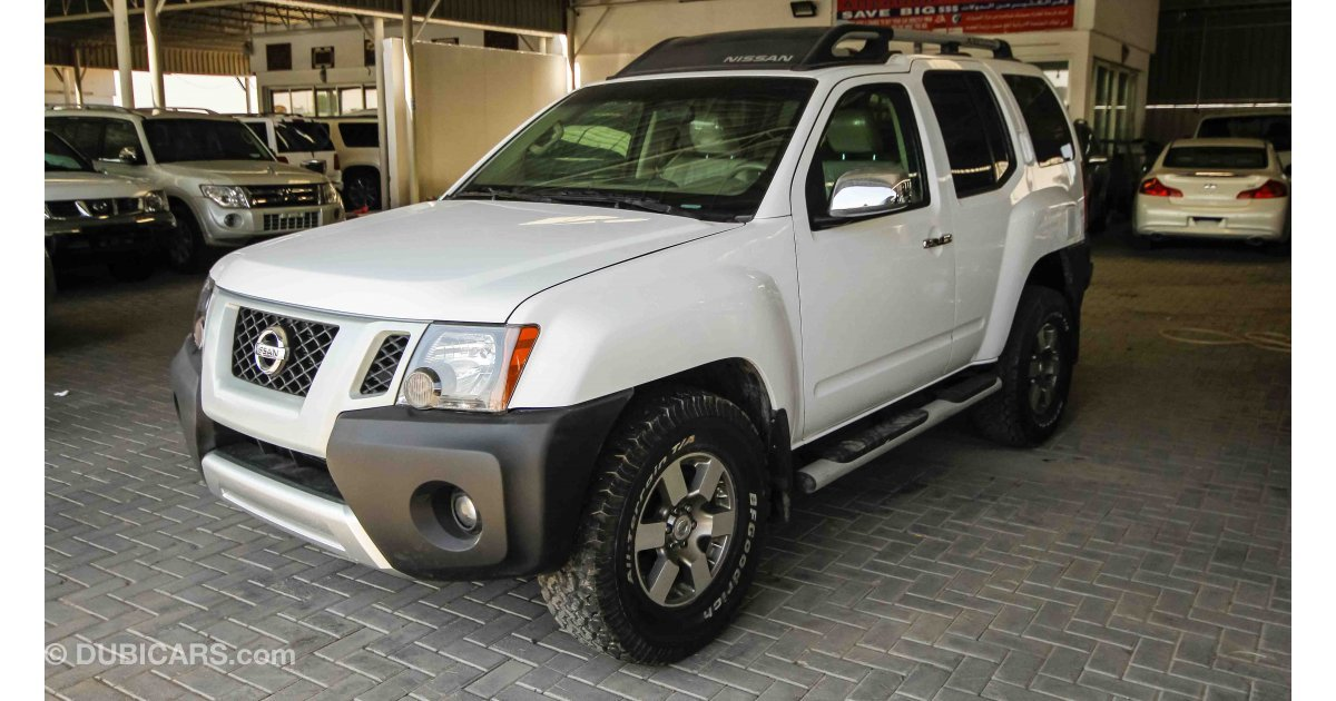 nissan xterra for sale aed 55 000 white 2014. Black Bedroom Furniture Sets. Home Design Ideas