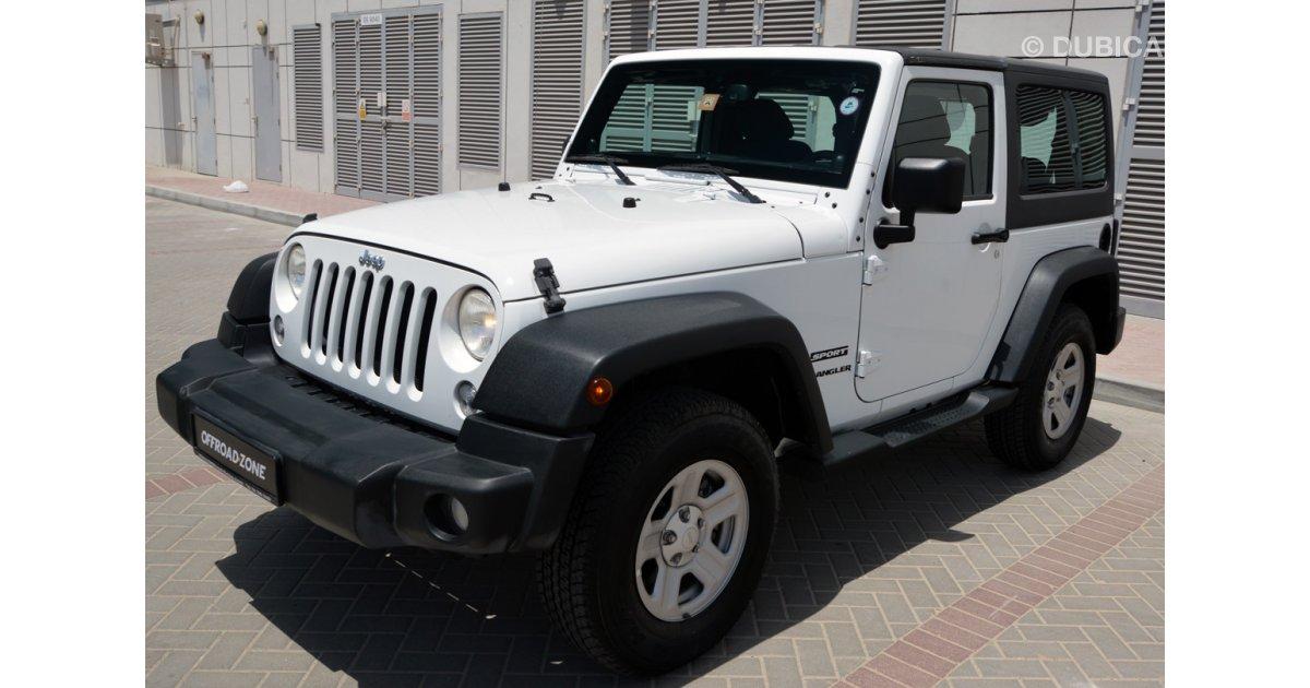 jeep wrangler sport 3 6l with manual transmission for sale aed 80 000 white 2014. Black Bedroom Furniture Sets. Home Design Ideas