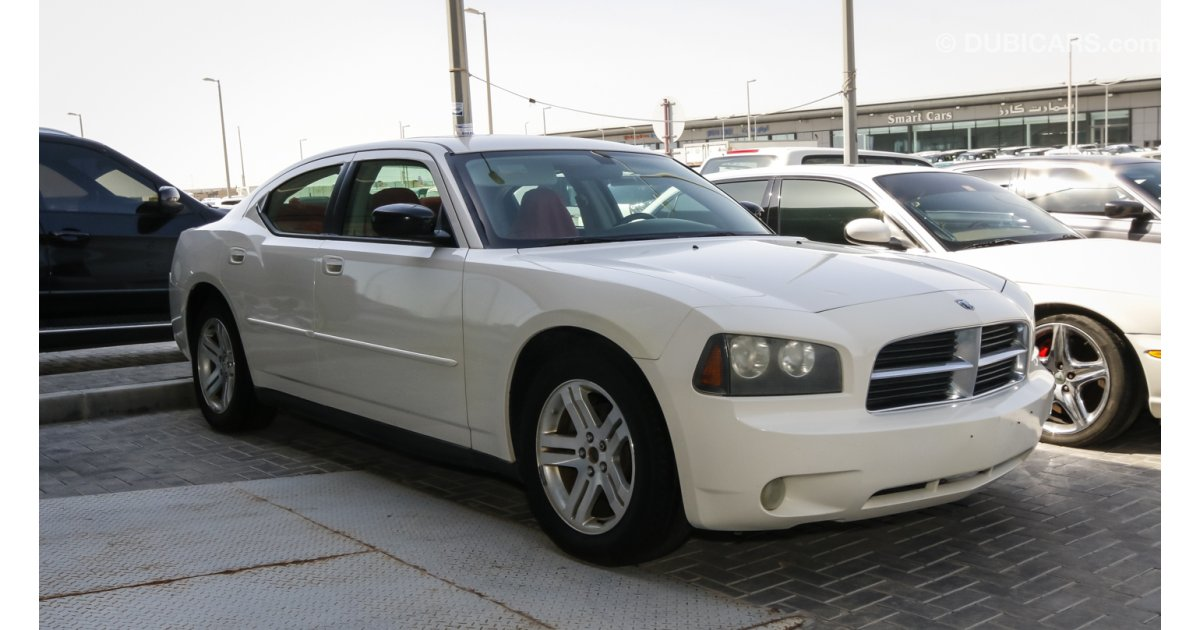 dodge charger sxt for sale aed 18 000 white 2007. Black Bedroom Furniture Sets. Home Design Ideas